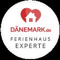 Jurorin für das Ferienhaus-Portal daenemark.de Ferienhaus-Experte-1-Badge rund